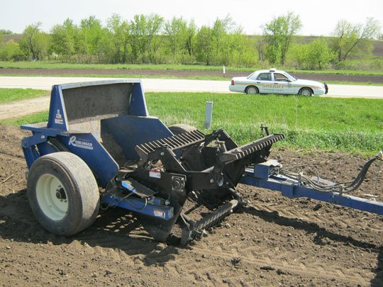 A Vinton man is in stable condition after being trapped in a piece of farm equipment Thursday afternoon.