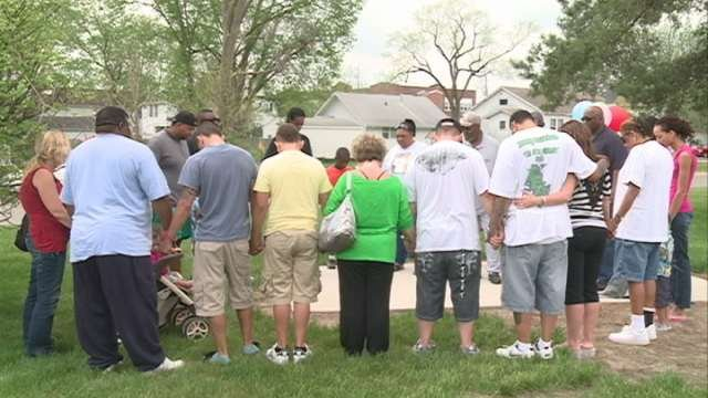 Dozens of people gathered around an Oak tree at Gates Park to remember homicide victims across Black Hawk County.