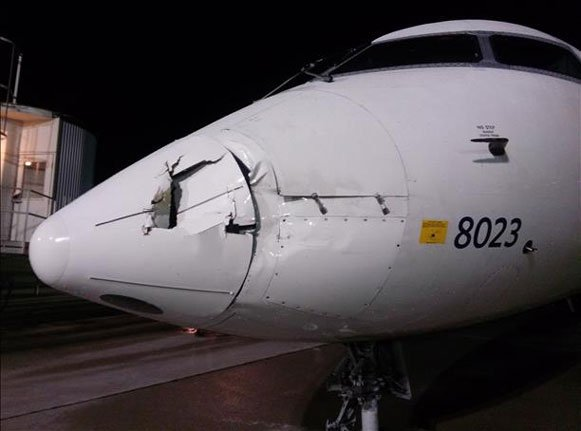 The winds treated a commercial jet parked at the Eastern Iowa Airport like a toy, pushing it more than 10 feet into a jet bridge.