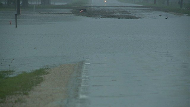 "The mayor of Parkersburg urges residents to stay away from flooded roadways as there is currently a ""swift current"" washing over the roads."