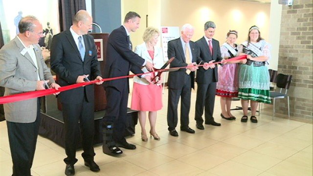 Former NASA astronaut Gene Cernan helped cut the ribbon for a new exhibit at the National Czech & Slovak Museum in Cedar Rapids Saturday