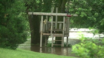 The swollen Wapsipinicon River is projected to cause major flooding for communities downstream from Independence.