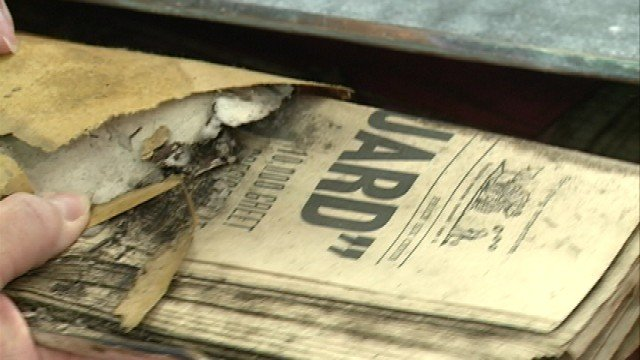 Inside a time capsule was a newspaper from the 1950s.