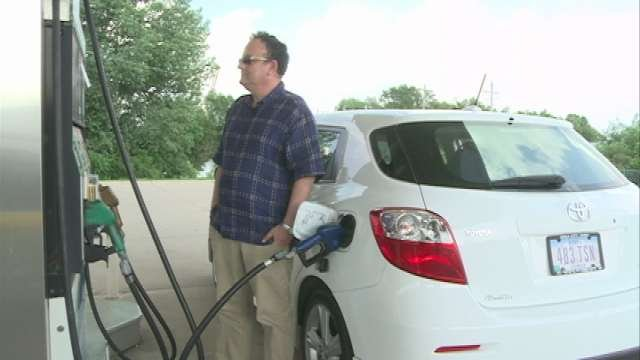 Joseph Zabner stopped for gas in Waterloo on Tuesday while driving his son from Iowa City to a summer camp in Minneapolis. He said the price of fuel weighed heavily in their travel plans.