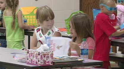 Kylee Kruse, 5, and Bridget Stock, 6, work as reading partners at Summer Academy Tuesday