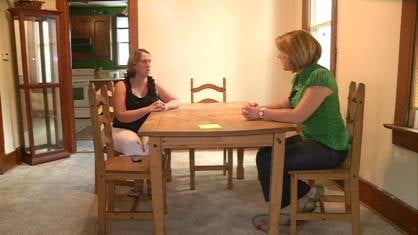 Suspect's fiance Candy Harris, left, speaking Wednesday with KWWL reporter Becca Habegger, right