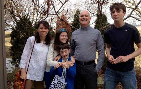 Julie Husband, left, with her husband and three children