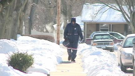 Dubuque letter carrier Dave Drexler delivers mail Monday in sub-zero temperatures