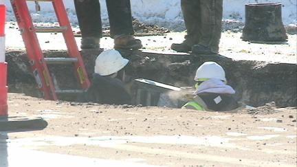 Dubuque crews work on a water main break repair Jan. 28, 2014