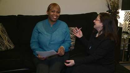 Desiree Dampier discusses her goals with a self-sufficiency coordinator from the Iowa City Housing Authority.