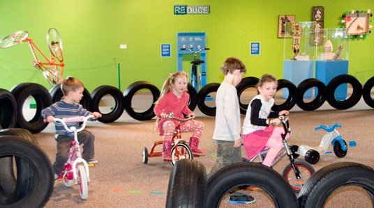Children participate in the Great Bicycle Recycle Exhibit at the Phelps Youth Pavilion Tuesday in Waterloo.