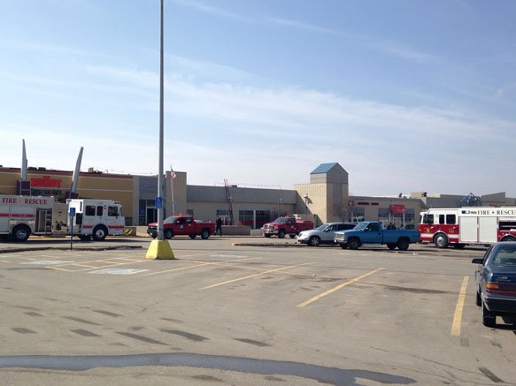 Crews respond to a reported gas leak at College Square Mall in Cedar Falls on Friday morning.
