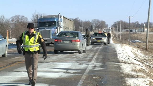Officials investigate the scene of the crash Tuesday morning near Independence