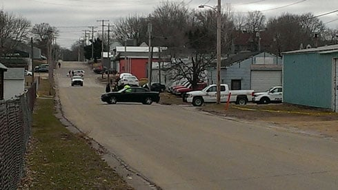 Police secure the scene of an officer-involved shooting in Maquoketa on April 1, 2014.