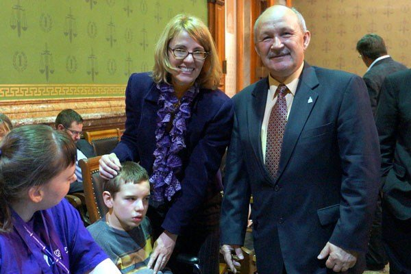 Iowa Sen. Bill Dotzler of Waterloo poses with Maria LaFrance of Des Moines and her son, Quincy, on April 15. (Courtesy Senate Press)