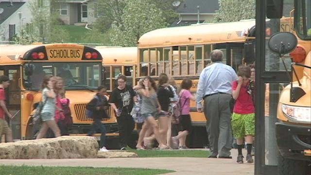 Students leave Dubuque's Roosevelt Middle School for the day Monday afternoon and head to the buses