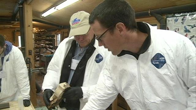 David Wadsworth teaches a workshop participant about restoring wooden windows