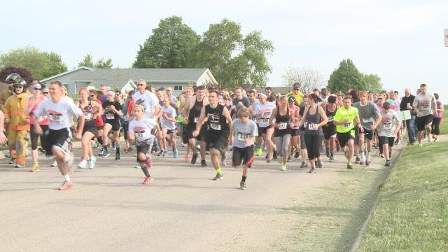 Runners take off from the 5k starting line in Parkersburg
