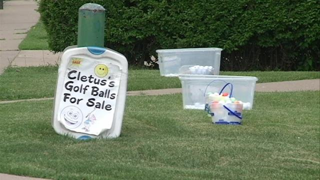 At 1410 North Grandview Avenue in Dubuque, Clete Meyer sells the used golf balls he hunts and cleans.