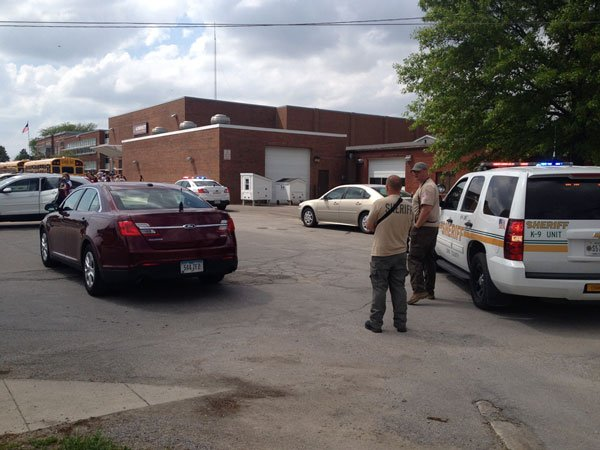 Linn County deputies investigate at Alburnett High School after a long gun was found on school property Wednesday afternoon.