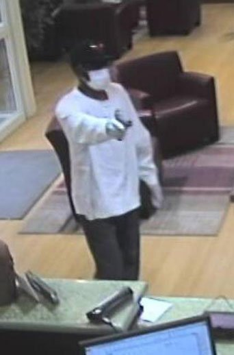 Surveillance images of a suspect robbing the Guaranty Bank in Cedar Rapids on Thursday.