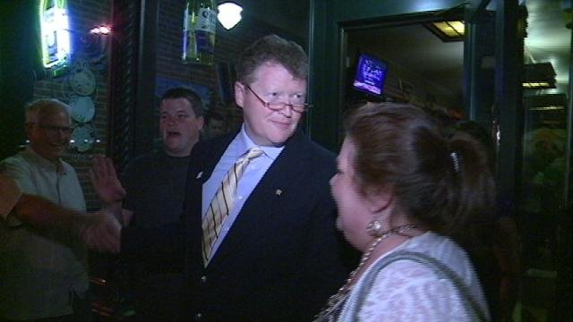 Rep. Pat Murphy (D-Dubuque) shakes hands outside his watch party Tuesday night in Dubuque
