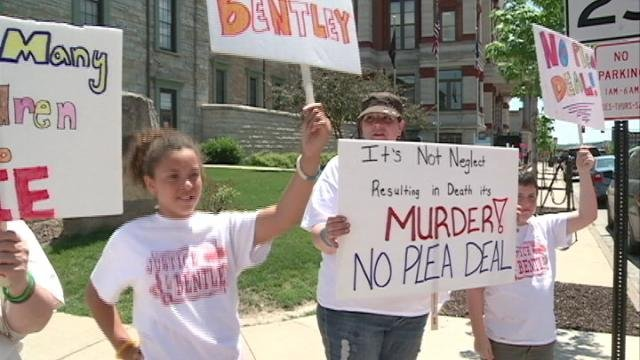 Bentley's family members protest outside the Dubuque County Courthouse Friday