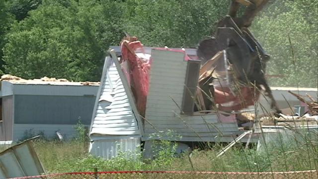 Crews work on demolishing Sageville's flood-damaged trailer park Monday morning
