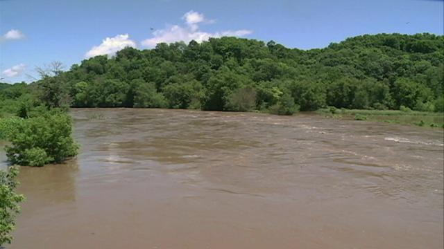 The swollen Turkey River flows near Garber Friday afternoon