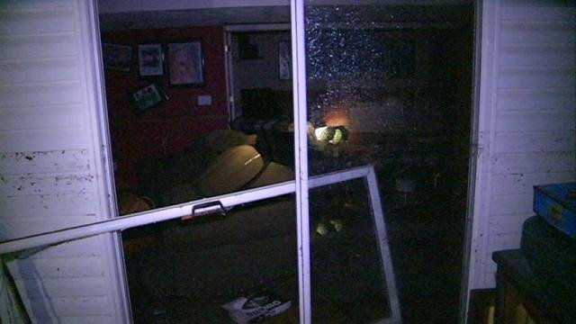 A wall of flood water burst through the basement of an Asbury home Sunday night