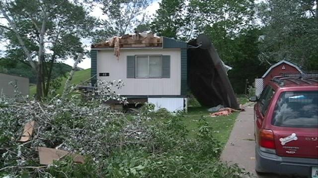 Wind ripped part of the roof off Don Thompson's mobile home Monday in Dubuque County