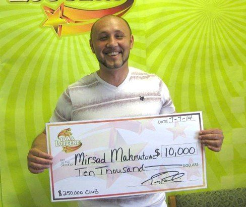 Mirsad Mahmutovic claimed the first of 32 prizes of $10,000 available in the Iowa Lottery's new instant-scratch game.