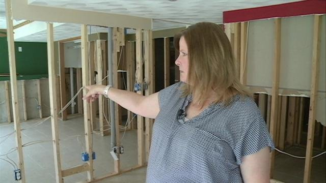 Lesley Voorhees points to what used to be her son's room, in the family's now-stripped-down basement.