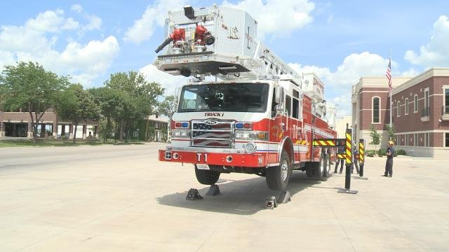 Cedar Rapids firefighters show off the new Truck 1's capabilities.