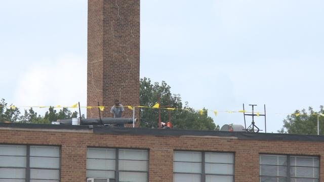 Crews fix the roof at Cleveland Elementary School in Cedar Rapids.