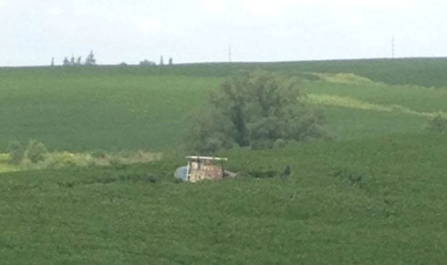 A crop-dusting helicopter lays on its side in a fied after crashing near Lancaster, Wisconsin.