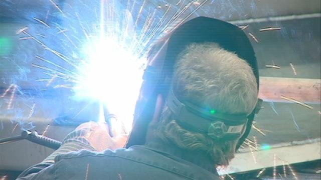 A welder is hard at work Thursday at Henderson Products in Manchester