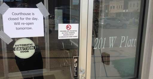 A sign up on the door of the Jackson County Courthouse on Tuesday. (Becca Habegger, KWWL)