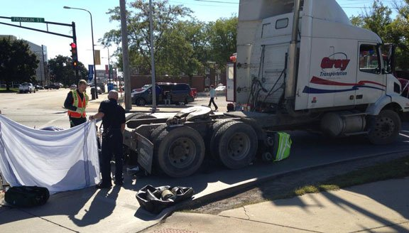 Emergency officials tend to a woman injured after a collision with a semi Tuesday afternoon in Waterloo.