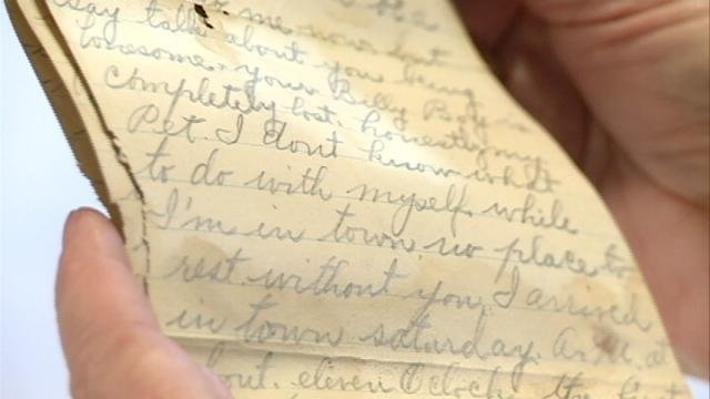 Rita Jones holds the 116-year-old love letter found in the wall of an old Wisconsin home she and her husband are fixing up