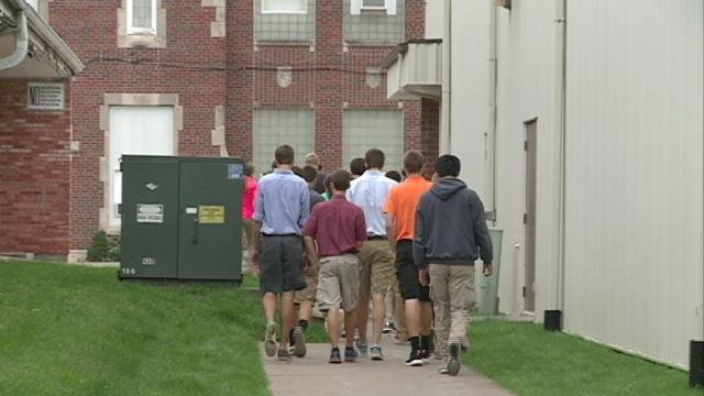 A group of Marquette Catholic school system students file back into class after an active shooter drill Thursday morning