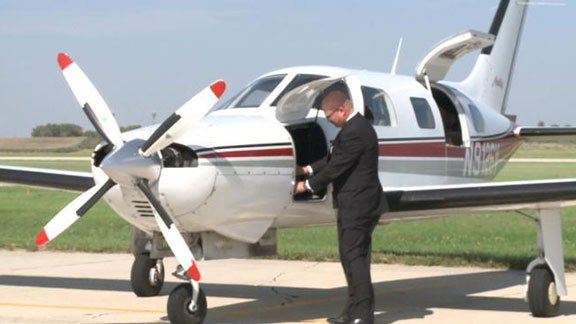 Doug Butzier, seen here with his plane during a campaign stop in Mason City. (Photo courtesy KIMT)