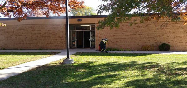 Crews fight a fire at Bunger Middle School in Evansdale on Wednesday morning. (Ally Crutcher, KWWL)