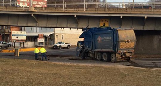 The garbage truck, after crews had tipped it back up. (Brad Hanson, KWWL)