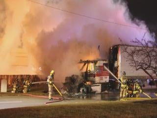 A semi engulfed in flames stopped traffic on Kerper Boulevard Monday evening.
