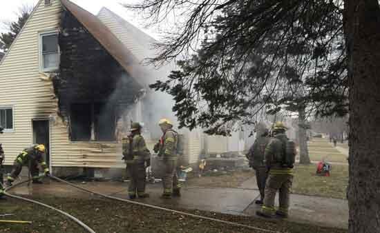 Waterloo fire crews battled a house fire on Cornwall Avenue on Dec. 9, 2014. (Lauren Moss, KWWL)