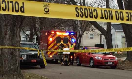 Fire crews found a body in a garage near a Waterloo house fire on Cornwall on Dec. 9, 2014. (Olivia Mancino, KWWL)