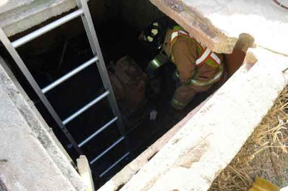Oelwein Fire officials descend into a Fayette County well to rescue a dog.