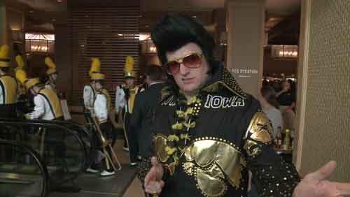"Greg Suckow, aka ""Hawkeye Elvis,"" fires up the Hawkeye faithful in Jacksonville, Florida, on Friday, Jan. 2, 2015."