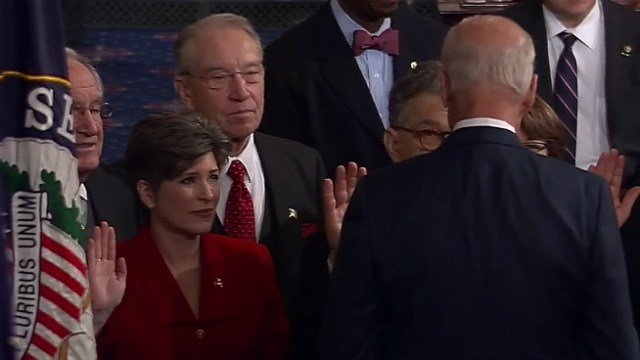 Joni Ernst takes the oath during a formal ceremony Tuesday morning